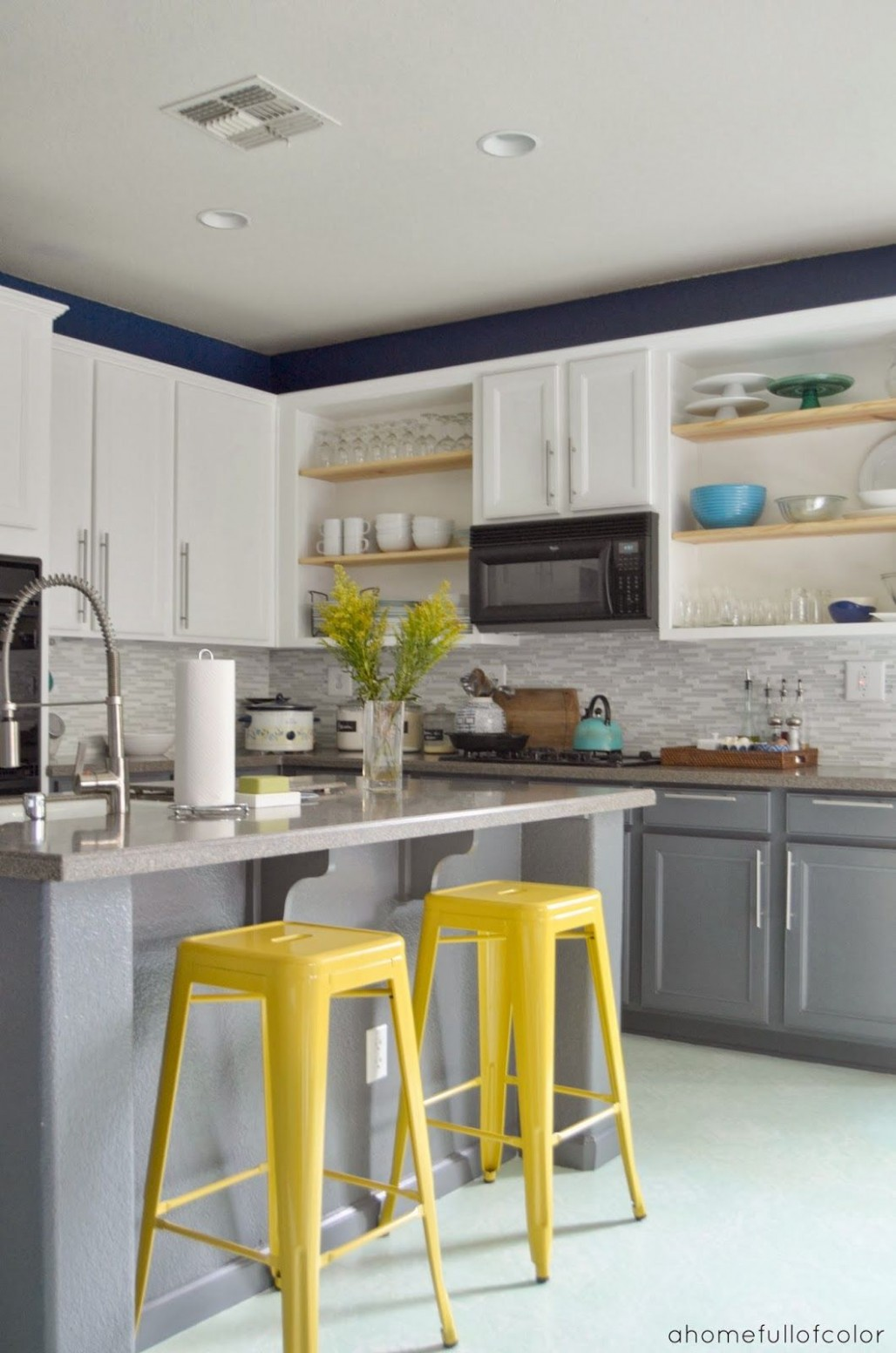 A Home Full Of Color:  Kitchen decor, Popular kitchen colors  - Yellow Kitchen With Blue Cabinets