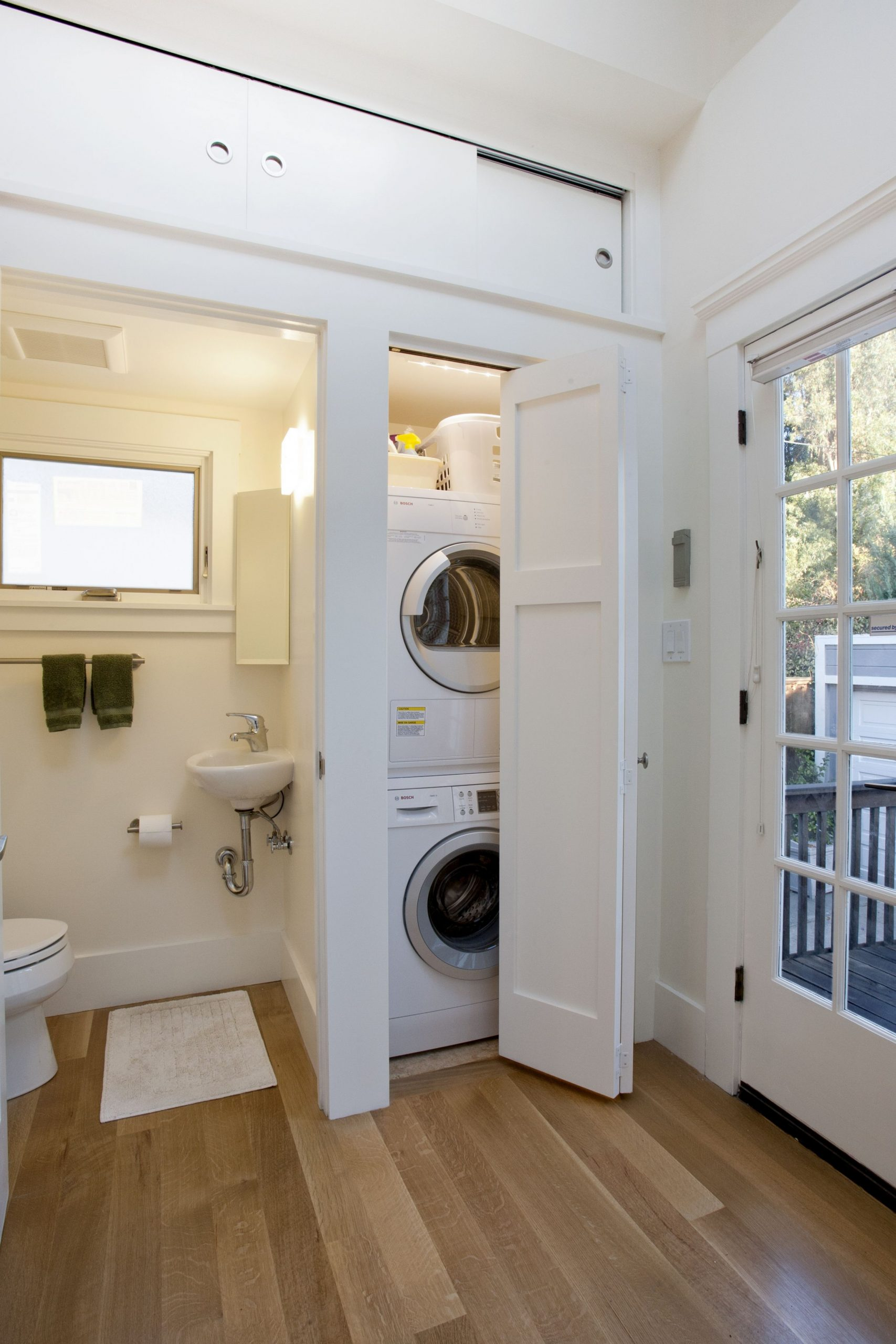 A new guest bath and laundry room were installed  Laundry room  - Laundry Room Guest Bedroom