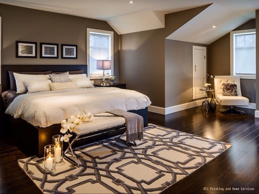 A warm and cozy bedroom with dark hardwood floors and brown paint  - Bedroom Ideas Brown