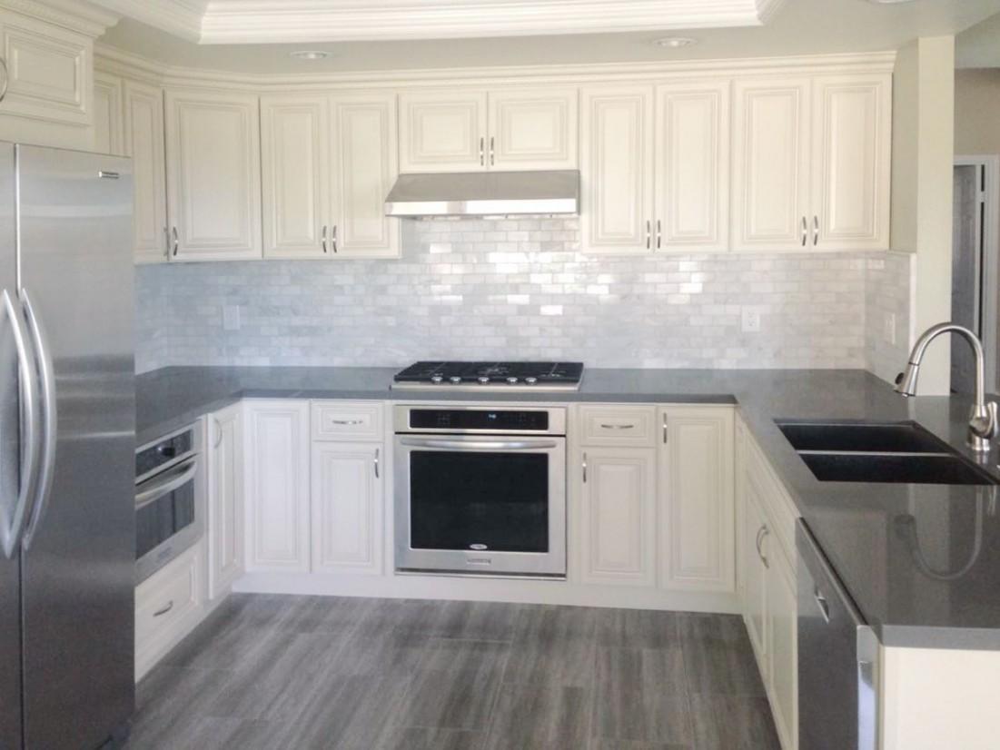 Antique White kitchen cabinet with grey quartz countertop  - White Kitchen Cabinets And Quartz Countertops
