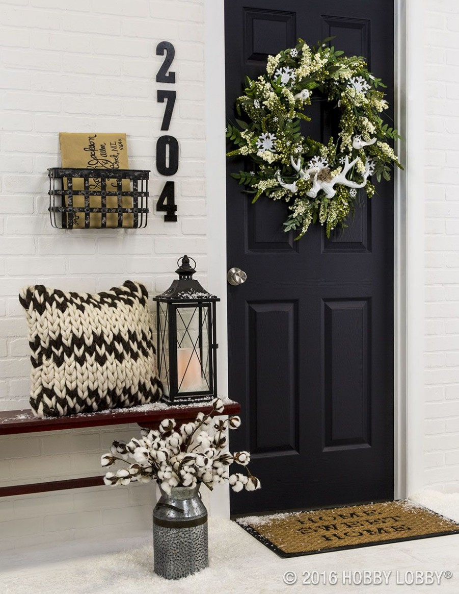 Incorporate front door decor that provides a welcoming energy to  - Apartment Door Decor Ideas
