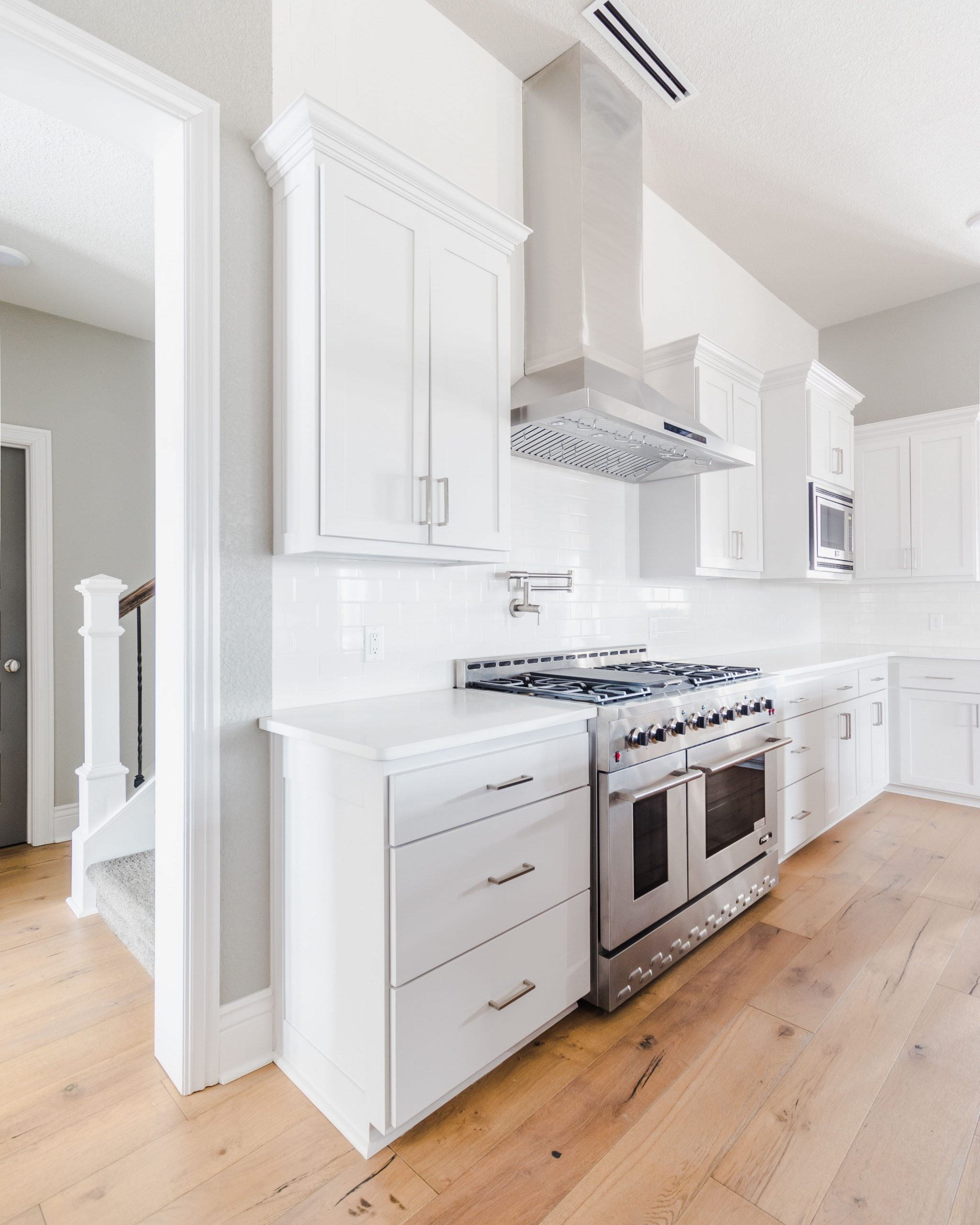 Modern traditional white kitchen with custom stainless range hood  - White Kitchen Cabinets And Quartz Countertops
