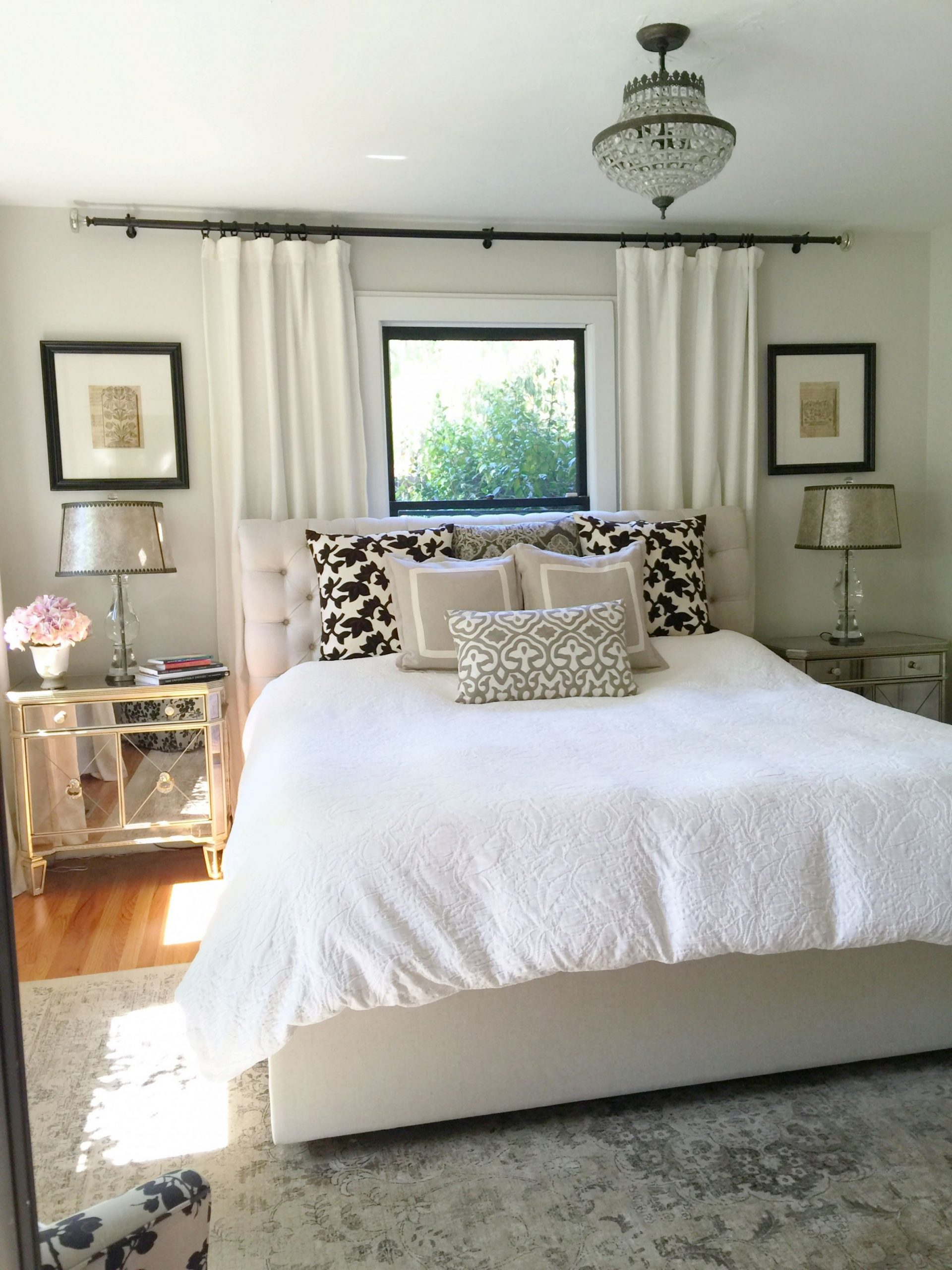 Neutral bedroom. Window behind bed