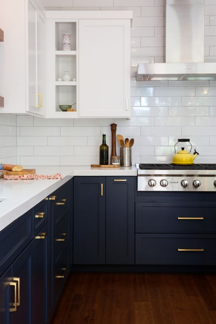The Top 9 Colors to Decorate With Now  The Everygirl dark navy  - Kitchen Designs With White Upper Cabinets And Dark Lower Cabinets