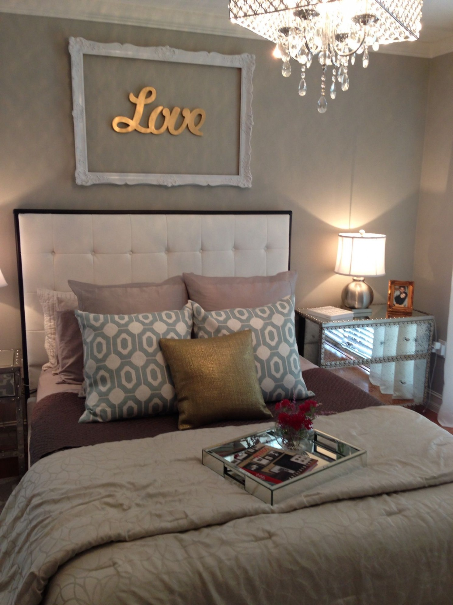 Too many different colors but I love the decor above the bed  - Bedroom Ideas Silver