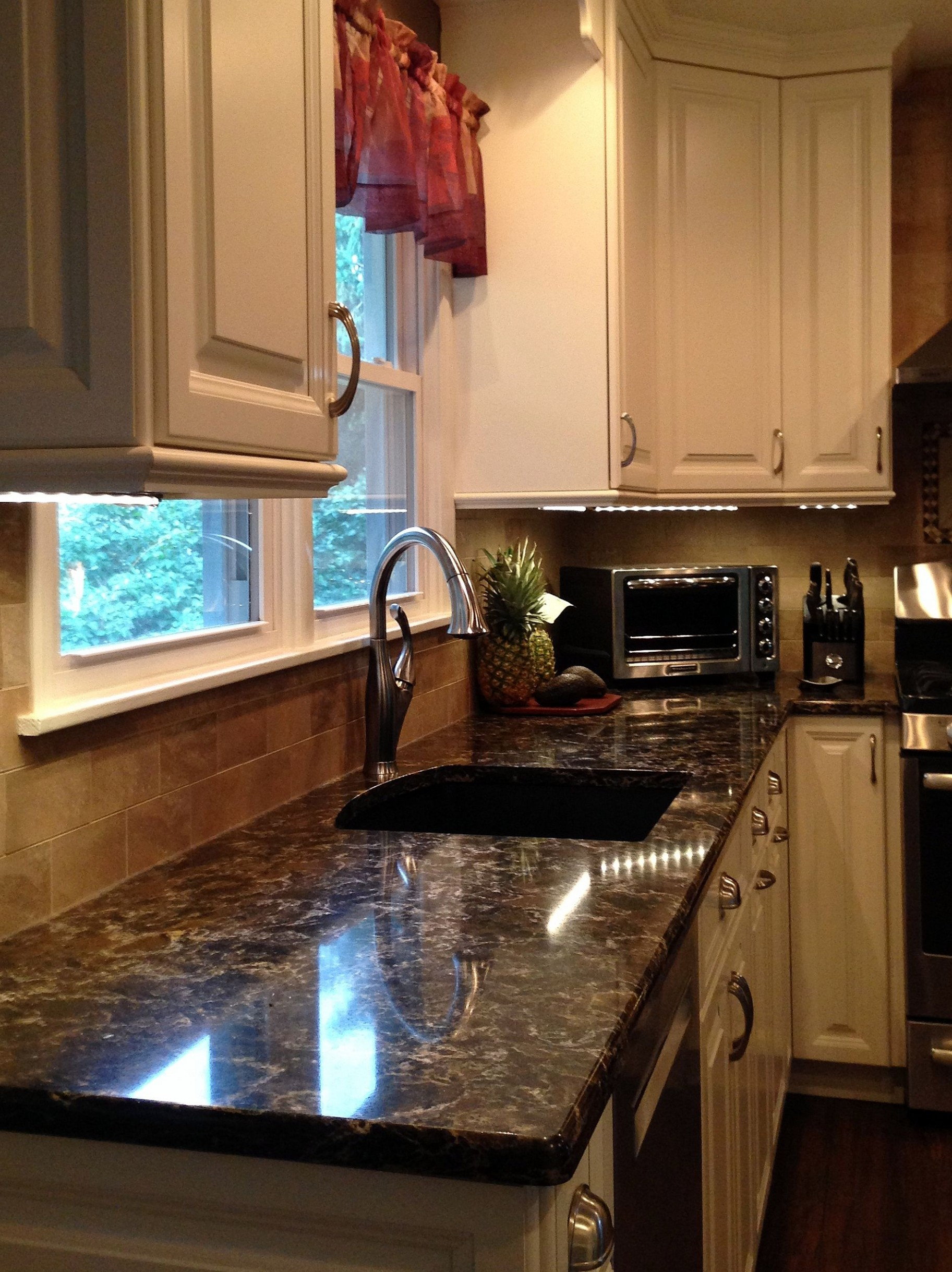 White Millbrook kitchen with laneshaw quartz countertops (12 of 12  - Millbrook Kitchen Cabinets