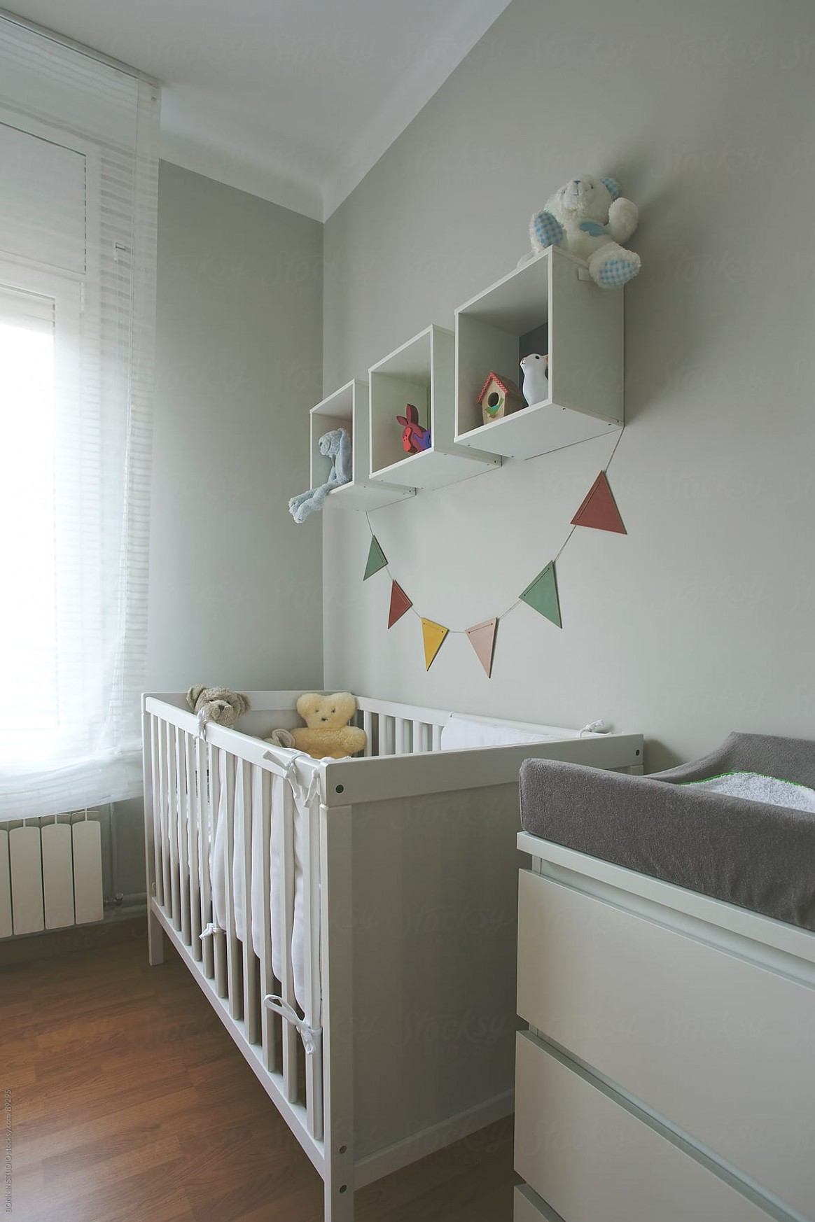 A cute baby room with colorful garland. Pastel tones