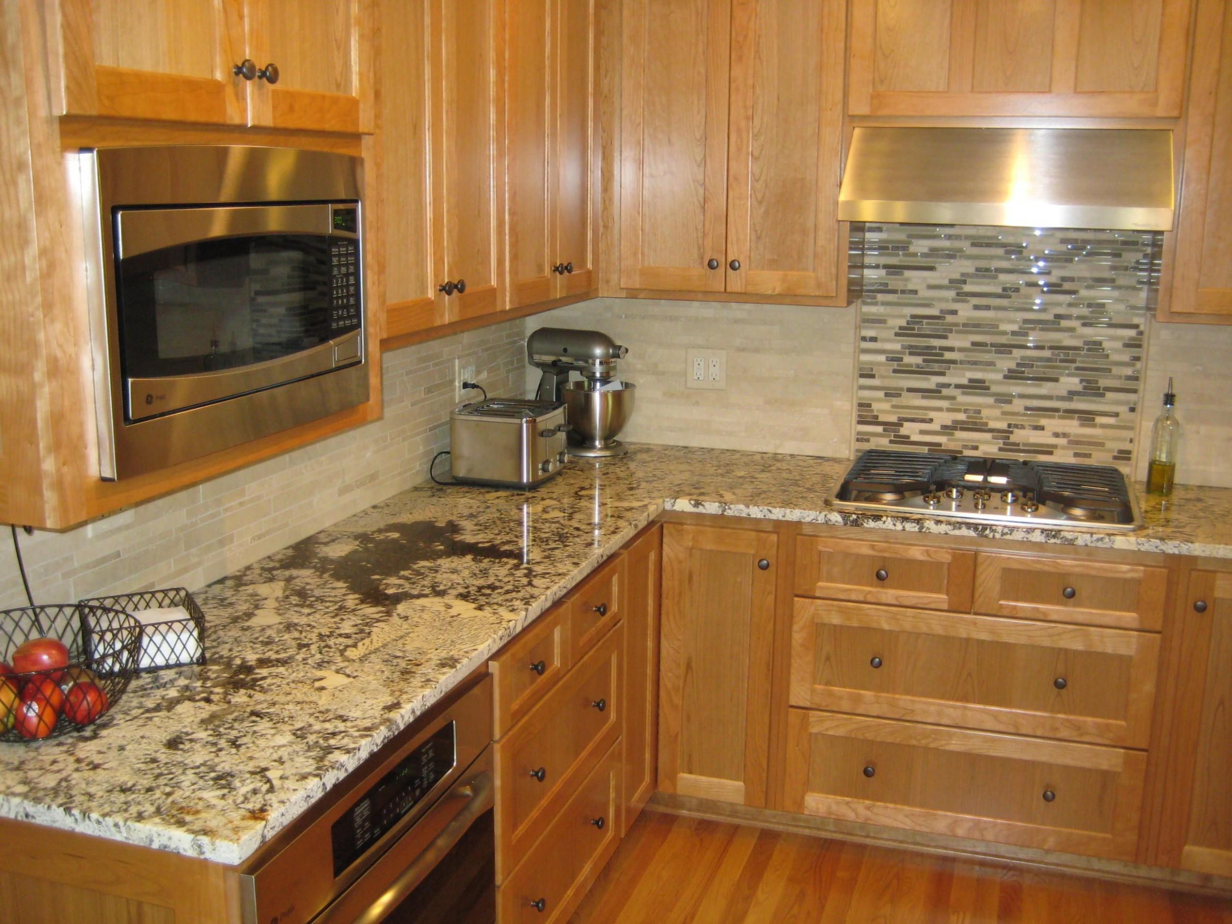 Bianco Antico granite - like backsplash but not stove accent wall  - Kitchen Backsplash With Light Wood Cabinets