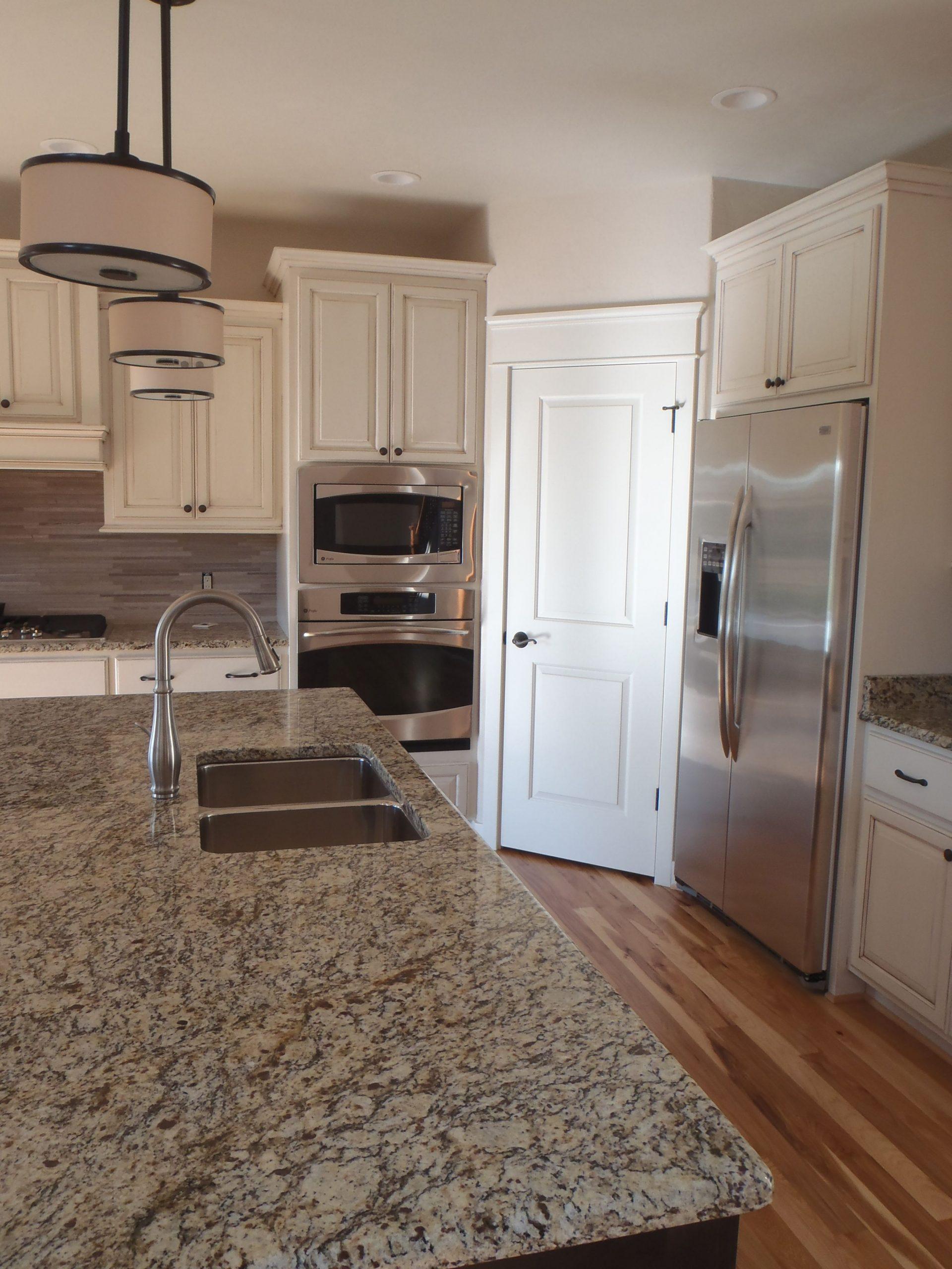 Carstensen Homes  Antique white kitchen cabinets, Antique white  - Antique White Kitchen Cabinets With Granite Countertops