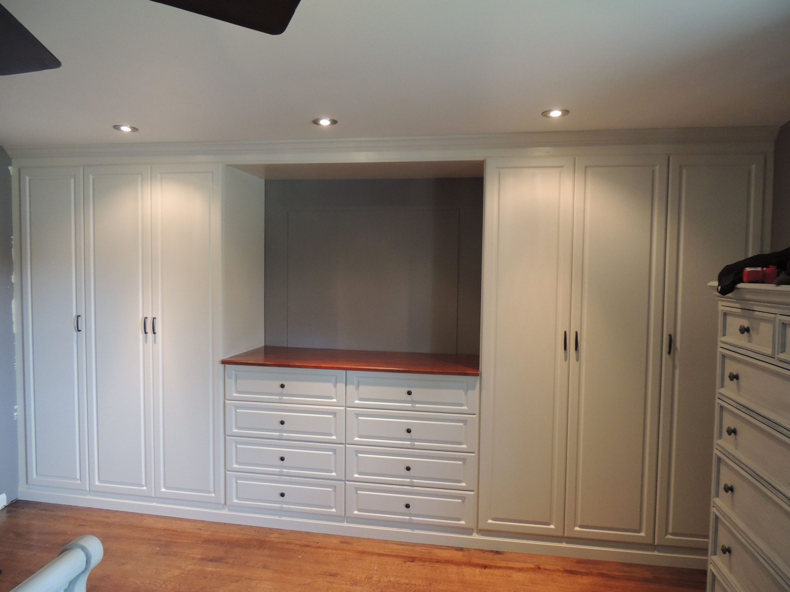 Custom white wall unit in a master bedroom  Bedroom wall units  - Closet Ideas Bedroom