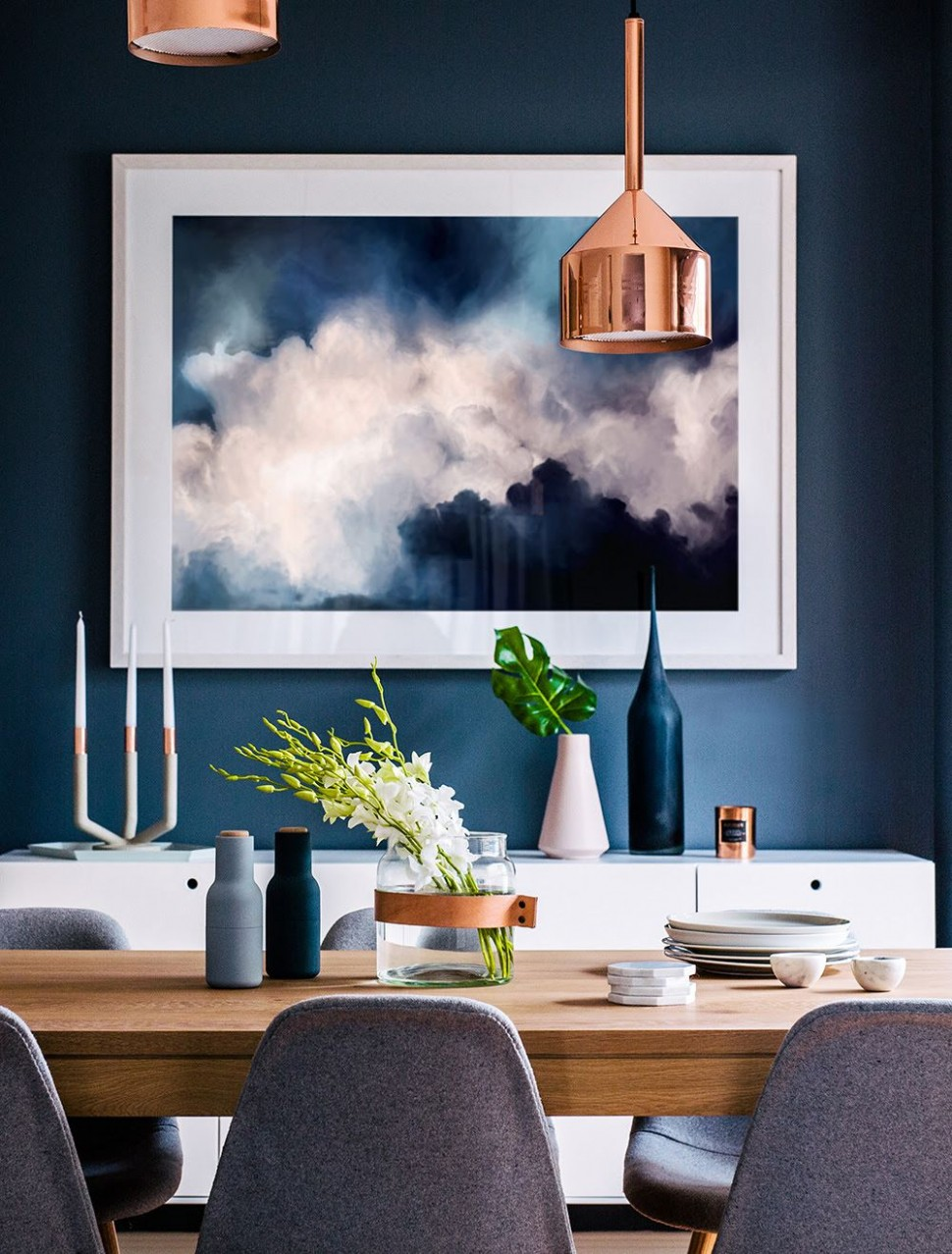 Dining room with deep blue wall and an interesting mix of  - Dining Room Ideas Blue Walls