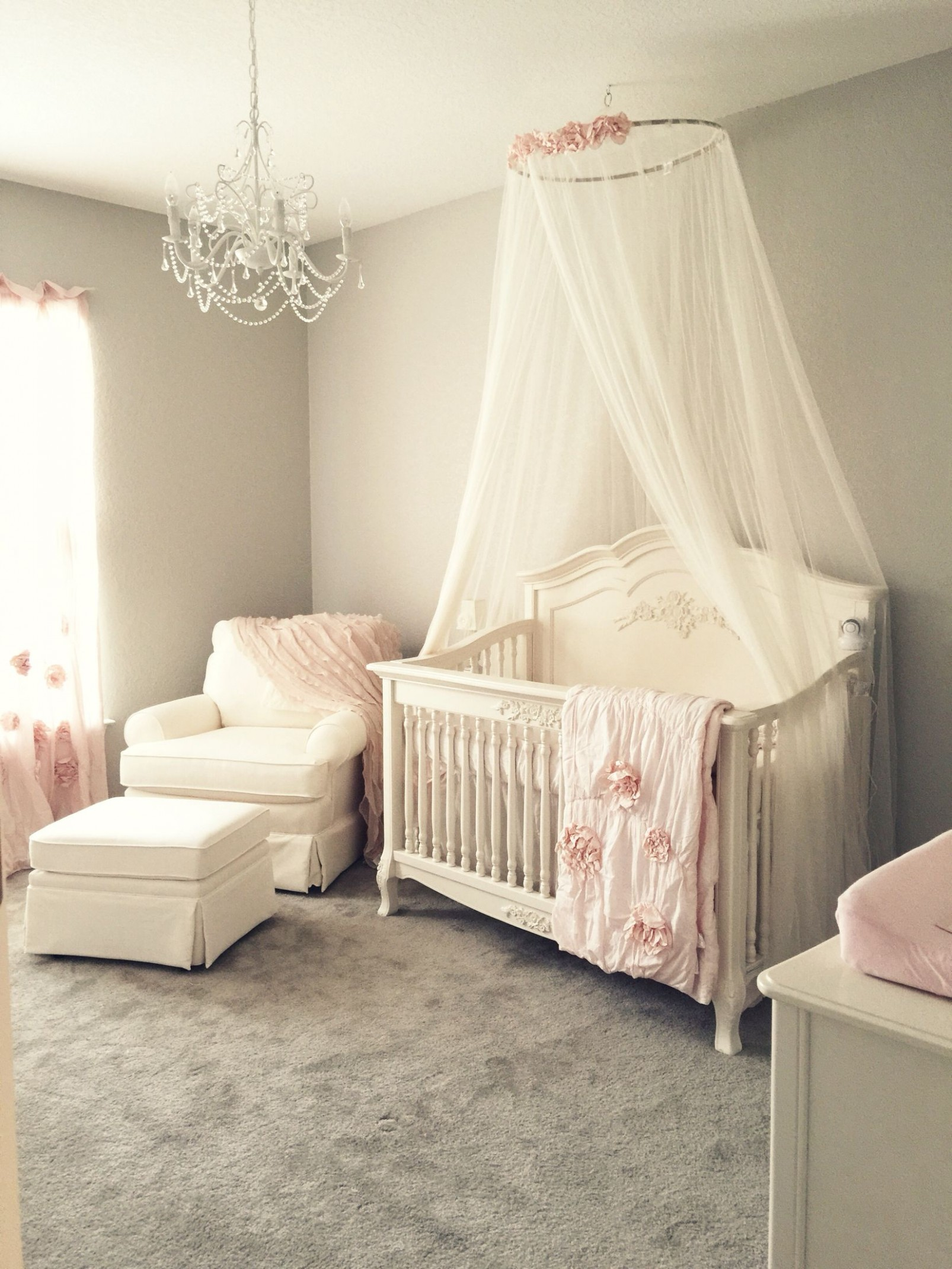 Girly pink blush nursery with chandelier, ivory rocker and glider  - Baby Room Chandelier
