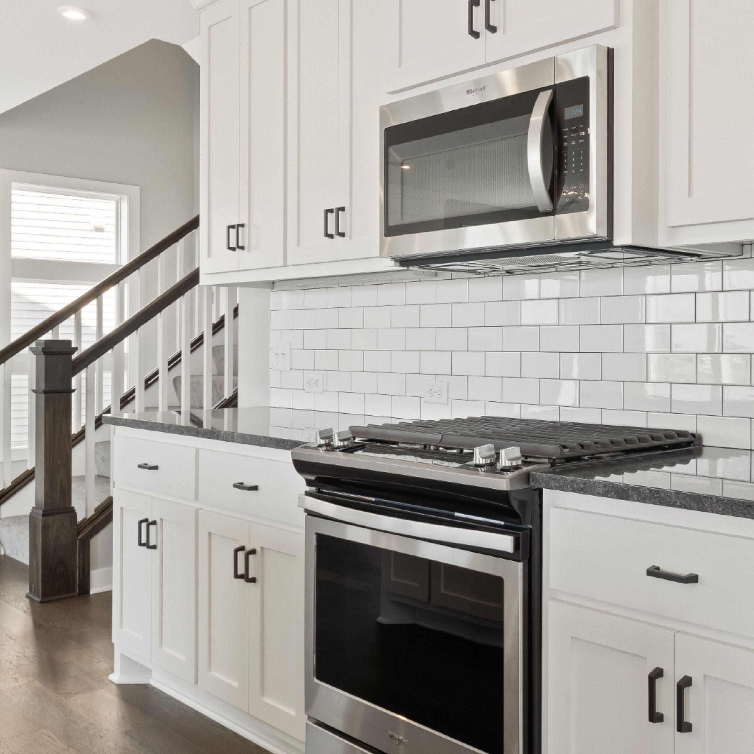 Hanson Builders - Newport Kitchen in 11  Black granite kitchen  - Hanson Kitchen Cabinets