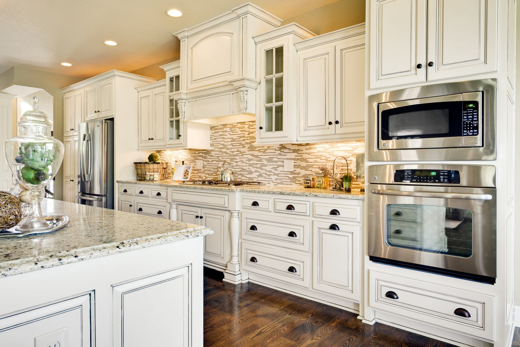 How much do Granite Countertops Cost?  CounterTop Guides - Antique White Kitchen Cabinets With Granite Countertops