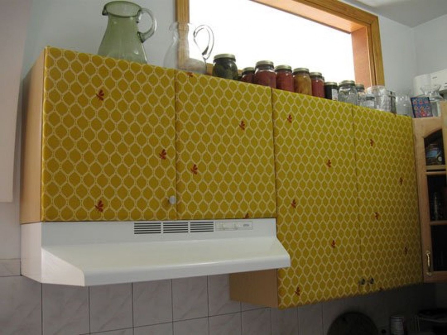 How To: Cover the Kitchen Cabinets In Fabric  Contact paper  - Temporary Kitchen Cabinet Covers