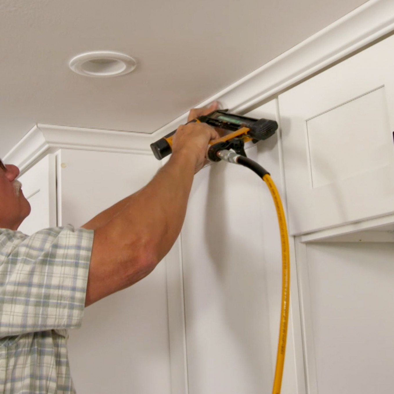 How to Hang Crown Molding on Kitchen Cabinets - This Old House - How To Attach Crown Moulding To Kitchen Cabinets