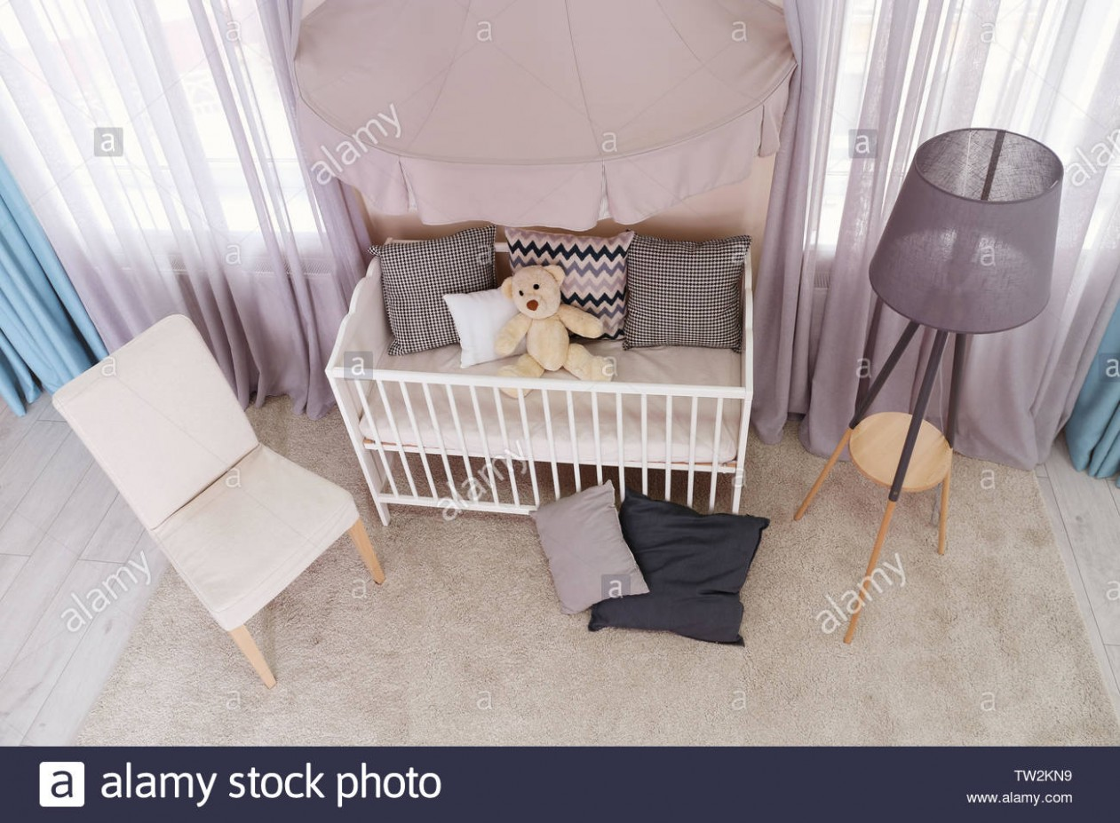 Interior of light baby room with furniture and tripod floor lamp  - Baby Room Floor Lamp