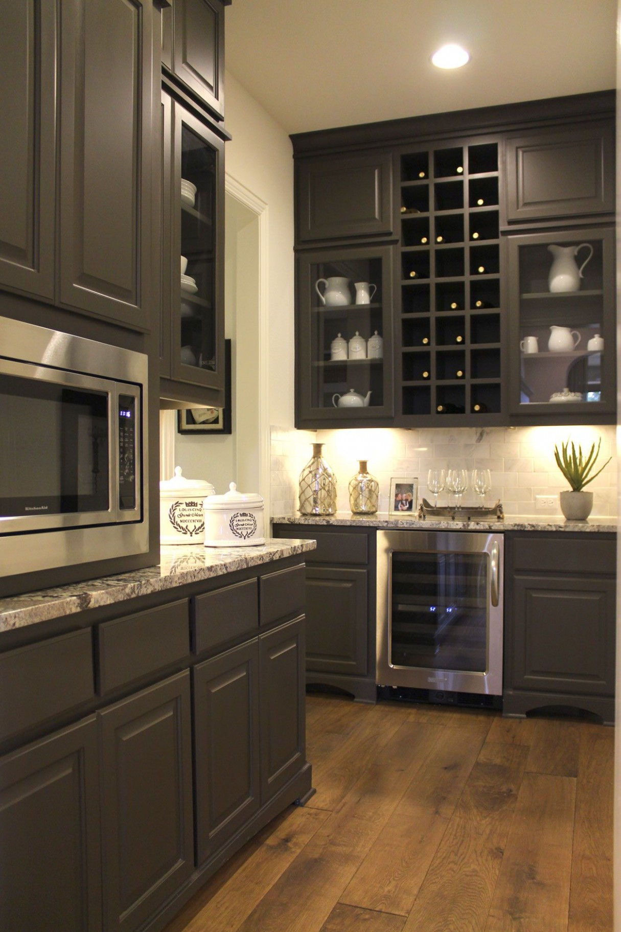 large pantry with cabinets - wine storage and glass doors  Wine  - Wine Fridge Kitchen Cabinet