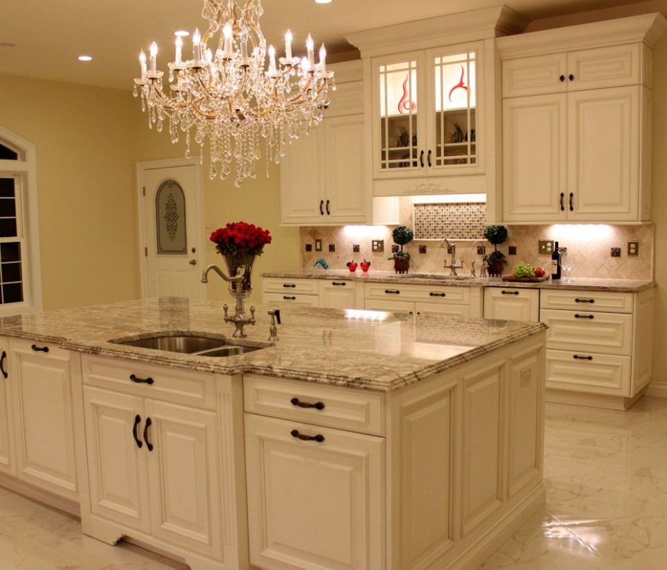Luxurious Kitchen w/Antique White Cabinetry & Sienna Bordeaux  - Antique White Kitchen Cabinets With Granite Countertops