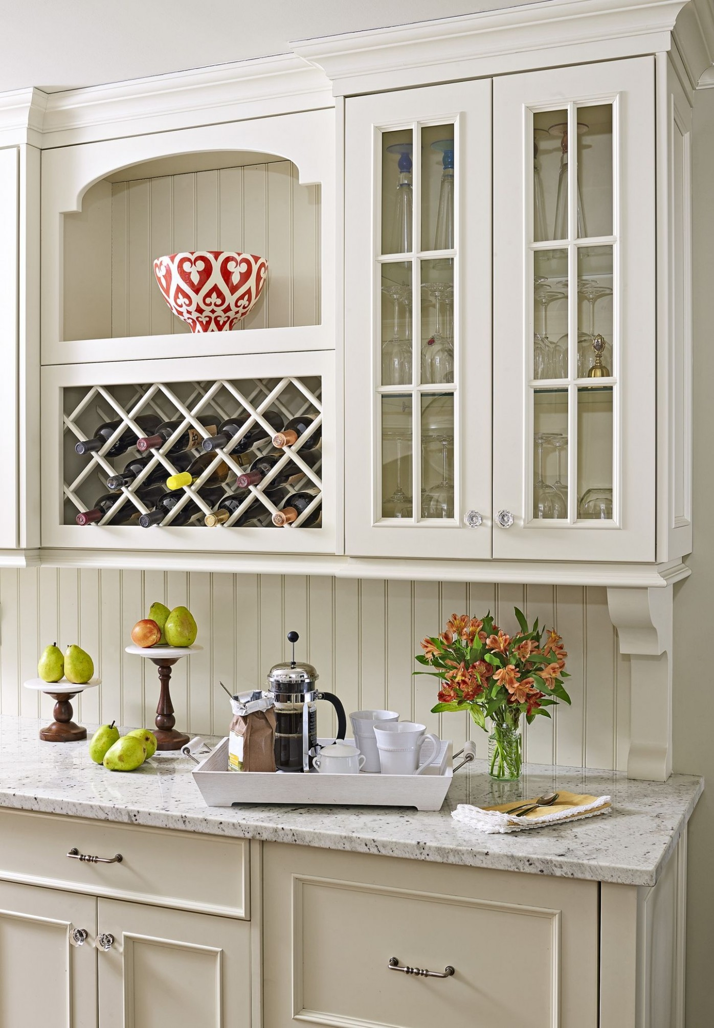 Marble countertops, a beadboard backsplash, and glass-front  - 1950S Kitchen Cabinets Corbel