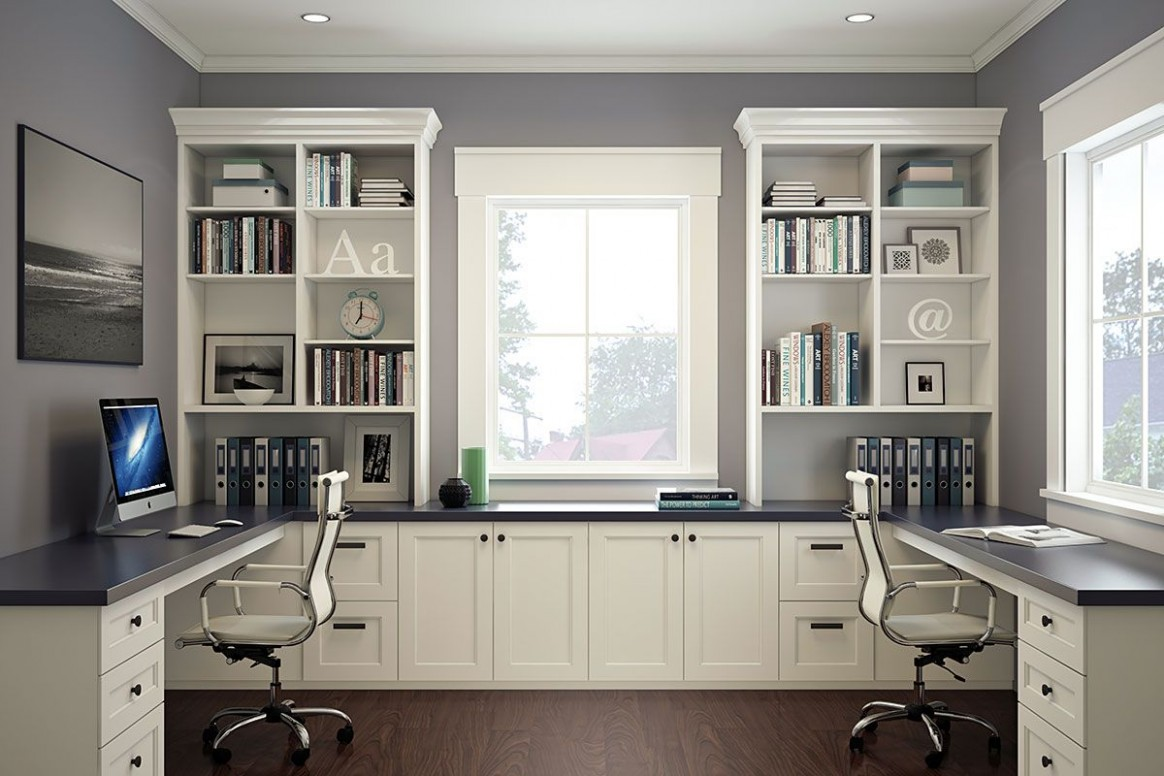 Modern, white home office with two desks and chairs
