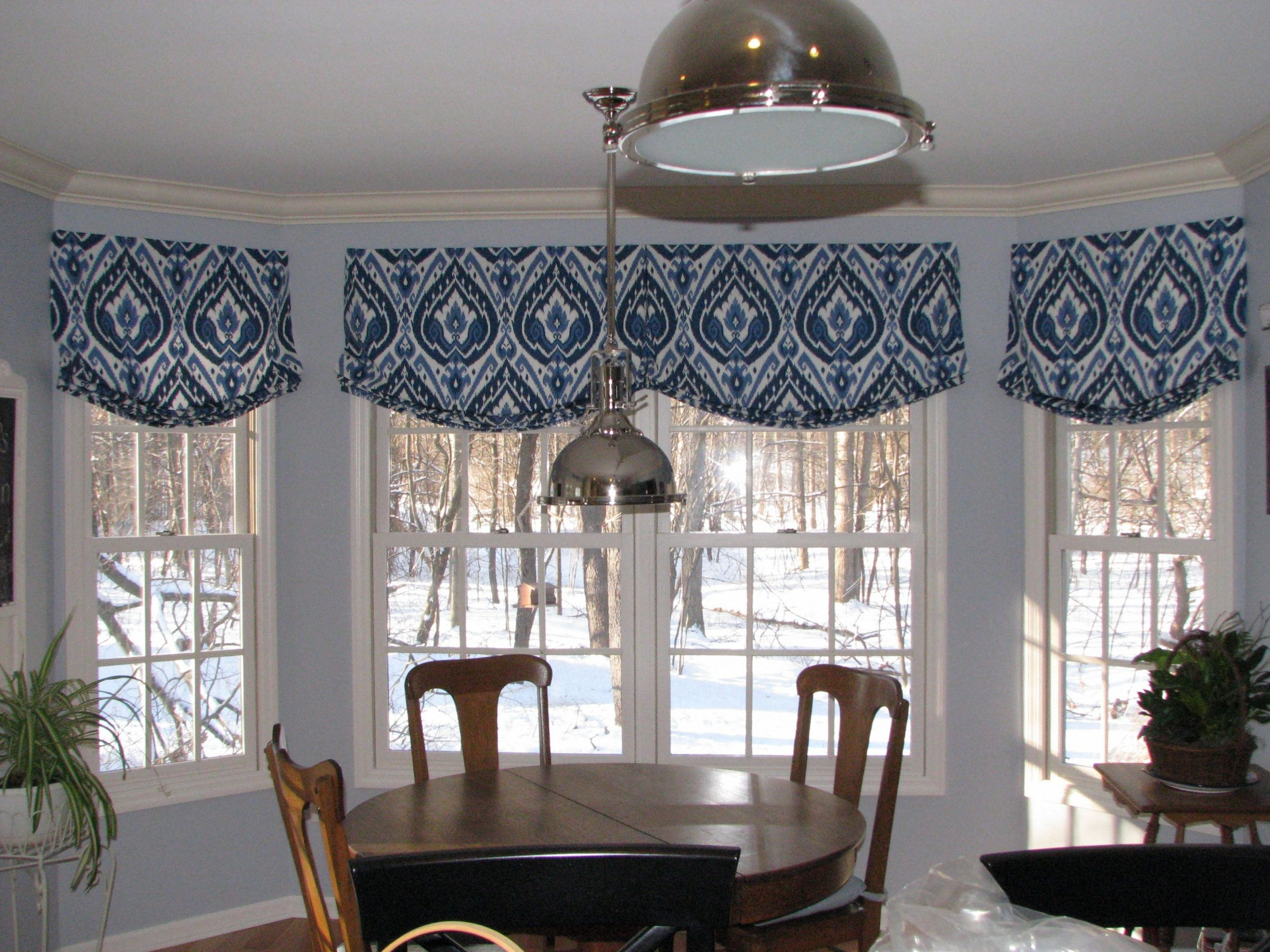 Relaxed roman shade valance in Ultra Marine Ikat pattern creates a  - Dining Room Window Valance Ideas