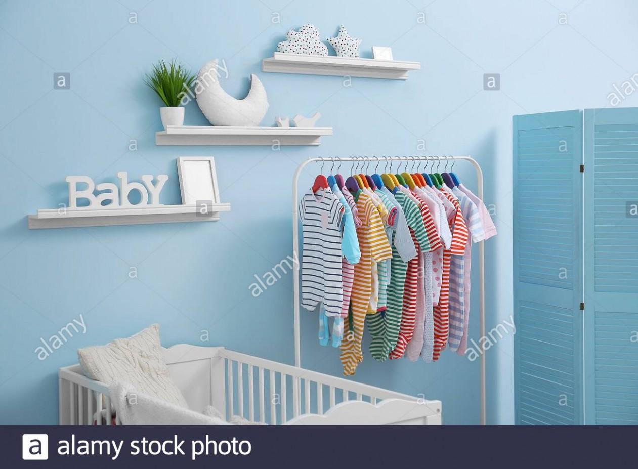 Shelves with hanger in modern baby room Stock Photo - Alamy - Baby Room Shelves