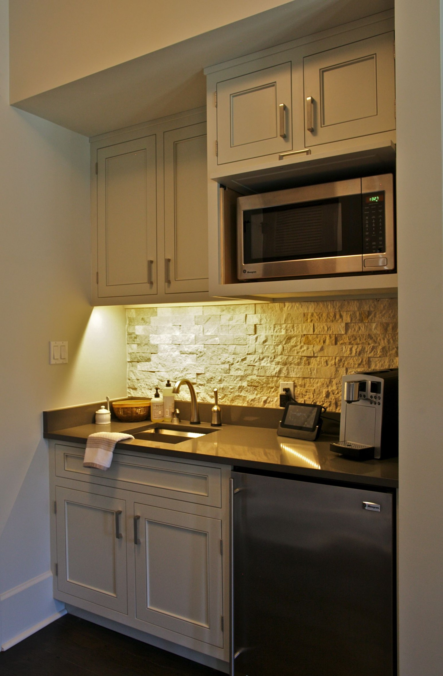 This coffee bar/kitchenette sits in a Master Bedroom for early  - Bedroom Kitchenette Ideas