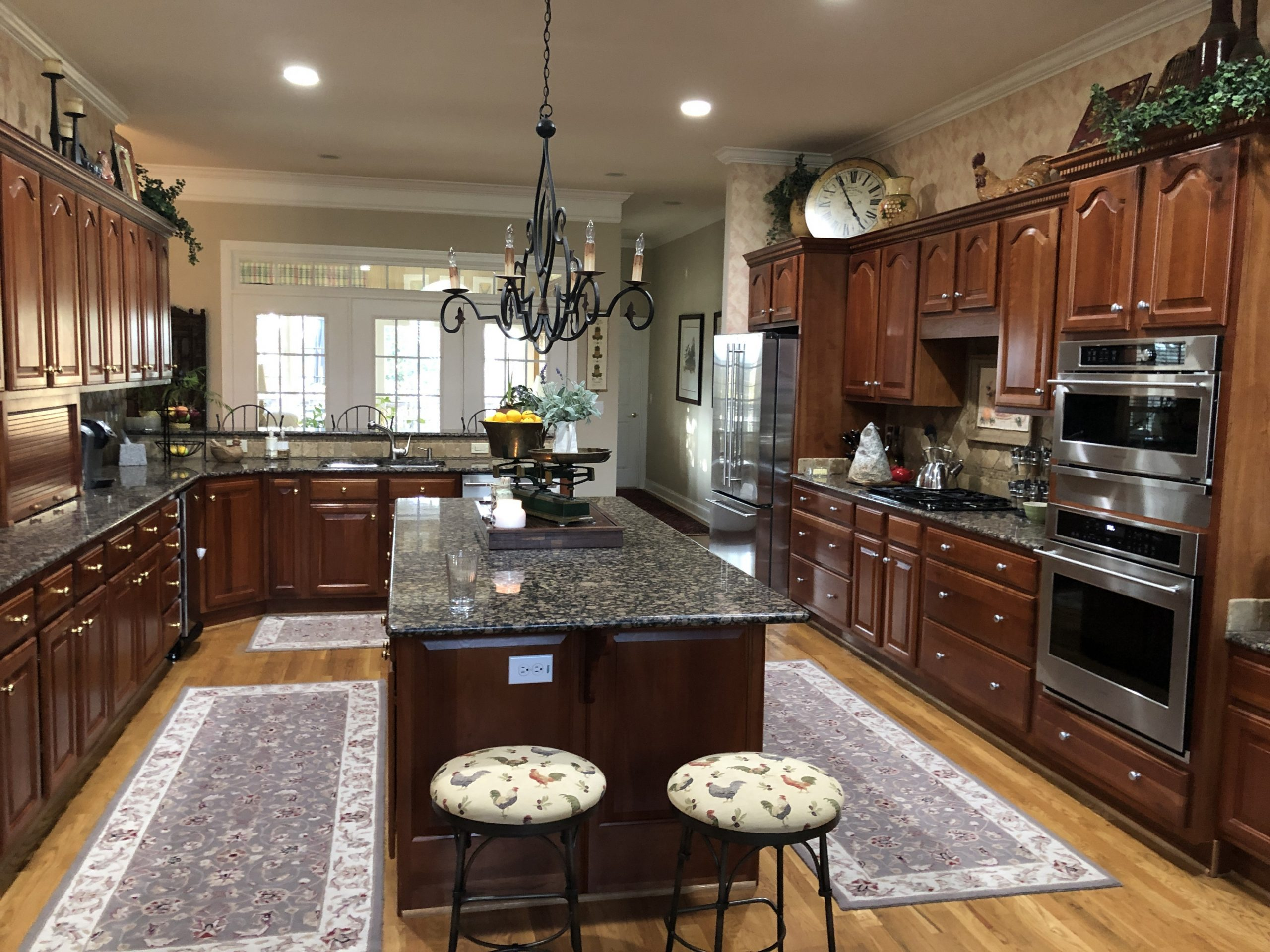 Traditional Kitchen Remodel- Bye Bye Cherry Cabinets - Bella Tucker - Kitchen Wall Paint Colors With Cherry Cabinets