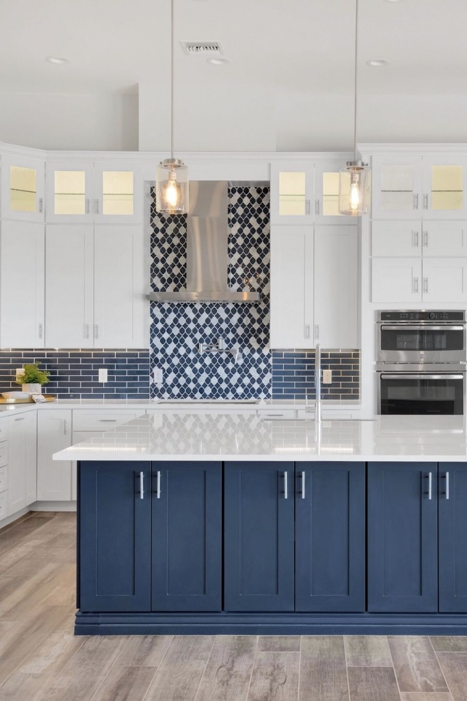 We love color! White kitchen cabinets and a blue kitchen island in  - Gray Kitchen Cabinets With Blue Backsplash