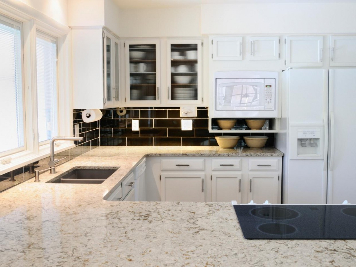 White Granite Kitchen Countertops: Pictures & Ideas From HGTV  HGTV - Kitchens With White Cabinets And Dark Granite Countertops
